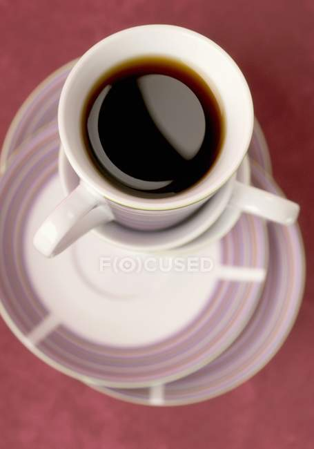 Espresso on pile of cups — Stock Photo