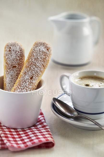 Closeup view of sponge fingers and coffee cup — Stock Photo