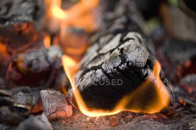 Closeup view of glowing and burning coals — Stock Photo