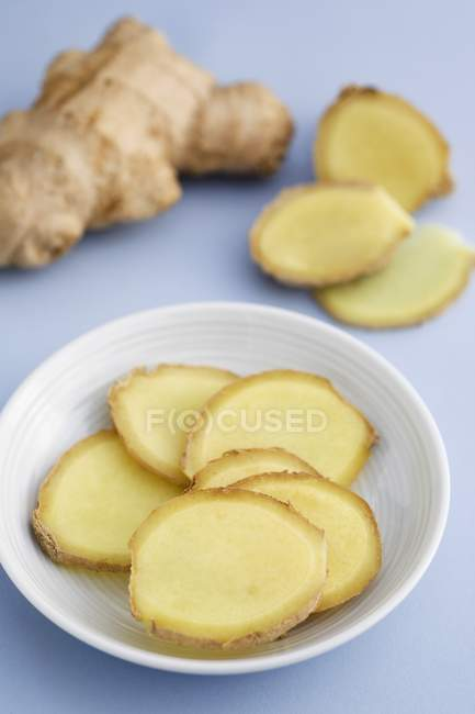 Sliced Fresh ginger in bowl — Stock Photo