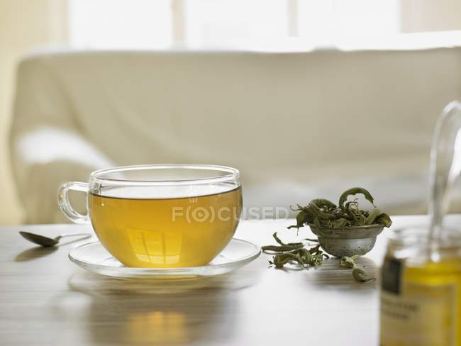 Herbal tea in a cup — Stock Photo