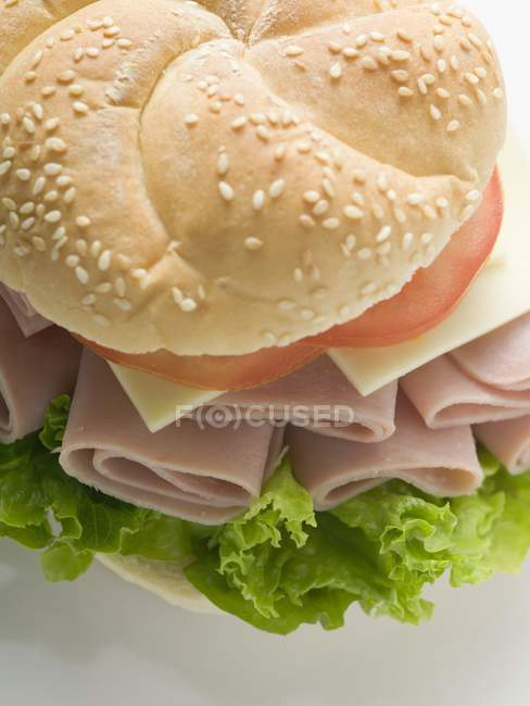 Sesame roll filled with ham — Stock Photo