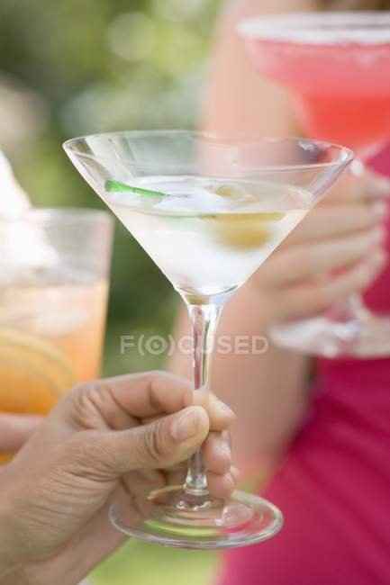 People toasting martinis — Stock Photo