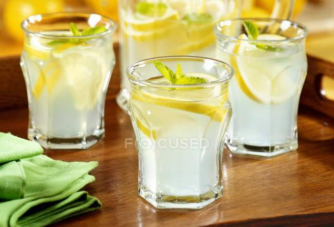 Lemonade in carafe and glasses — Stock Photo