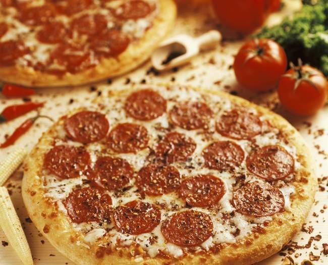 Baked salami pizzas — Stock Photo