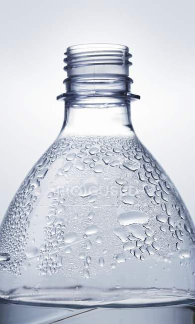 Closeup view of plastic water bottle with condensation — Stock Photo