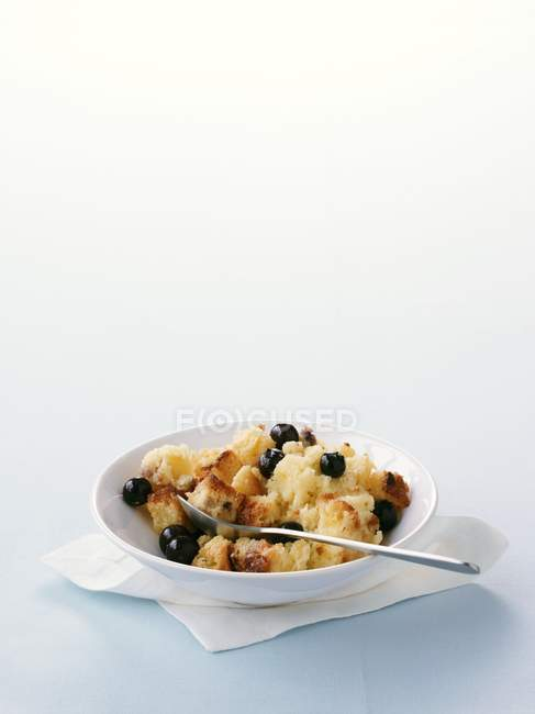 Bread and butter pudding with blueberries — Stock Photo