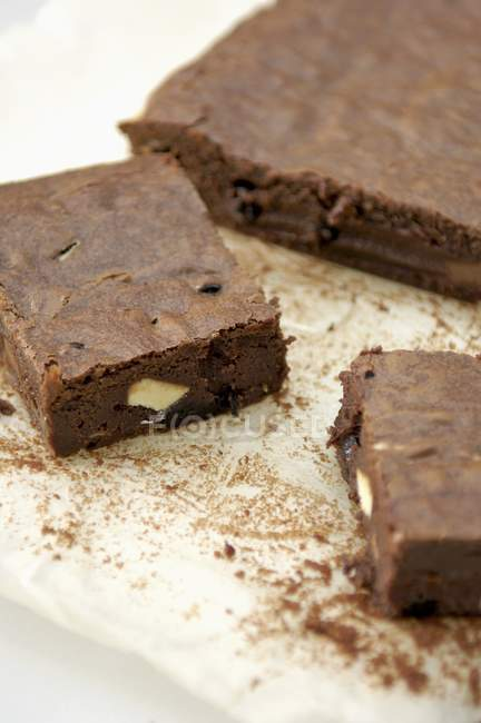 Nut brownies on baking parchment — Stock Photo