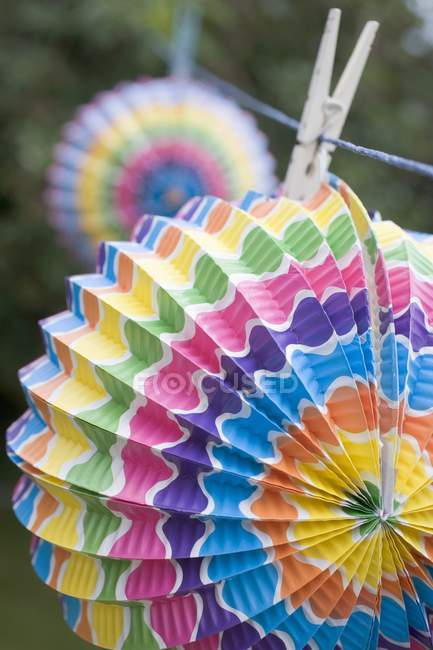 Colored Chinese lanterns on washing line in garden — Stock Photo