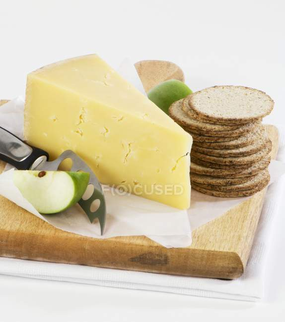 Piece of cheese with crackers — Stock Photo