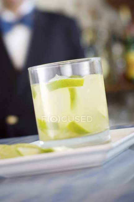 Closeup view of lime drink with ice cubes in glass — Stock Photo