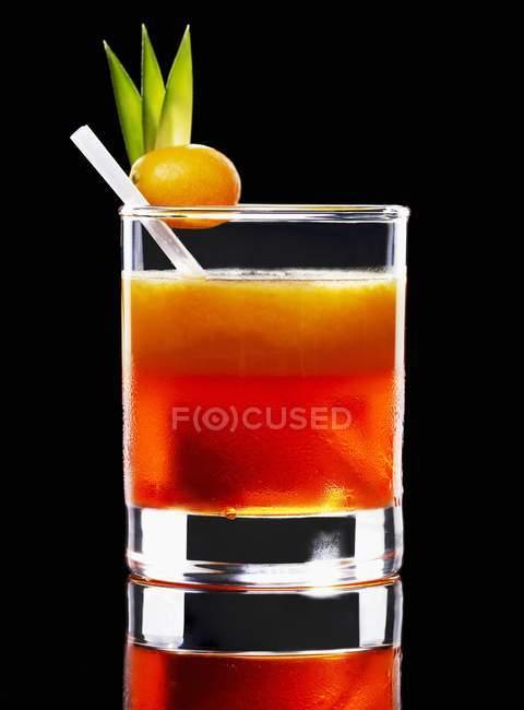 Orange alcohol cocktail in glass — Stock Photo