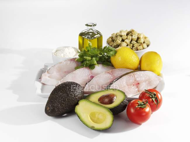 Ingredients for halibut with avocado on white background — Stock Photo