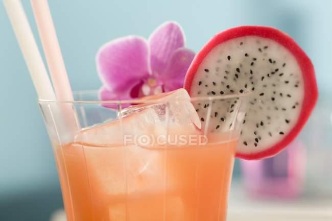 Fruity cocktail with pitaya slice — Stock Photo