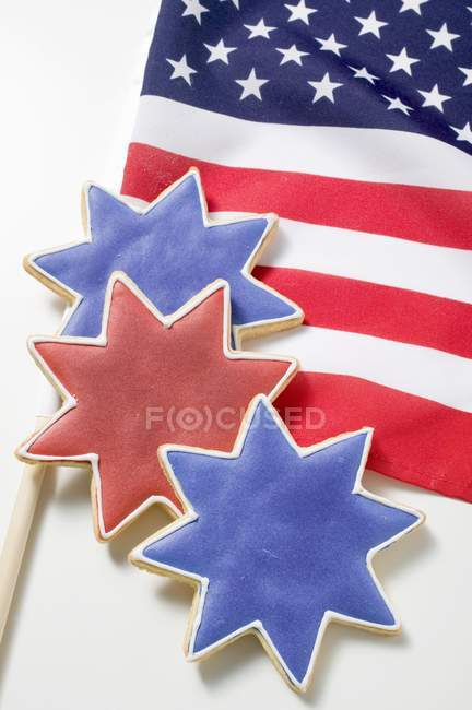 Closeup view of three star-shaped cookies on American flag — Stock Photo