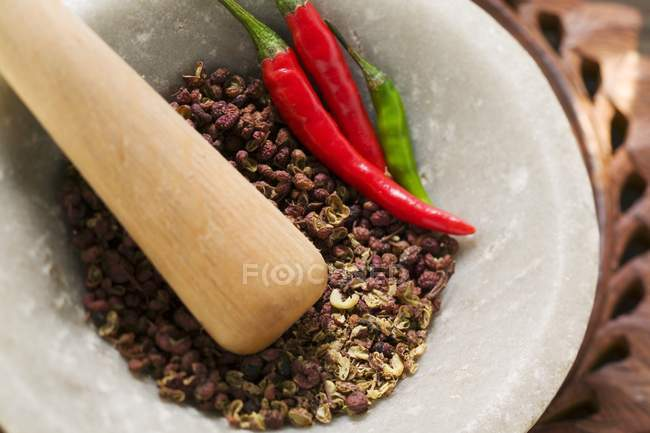 Szechuan pepper and chili peppers — Stock Photo
