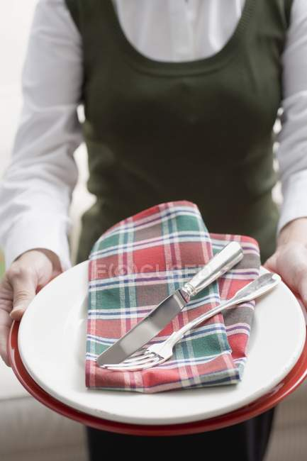 Woman holding tableware for Christmas — Stock Photo