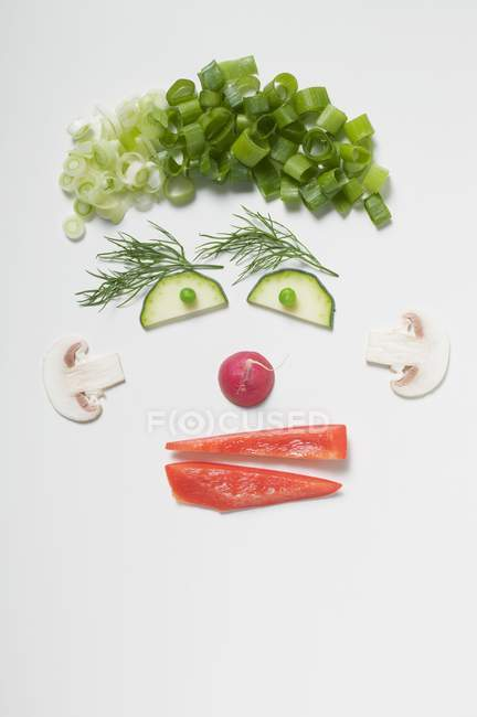 Amusing face made from vegetables, dill and mushrooms  on white background — Stock Photo