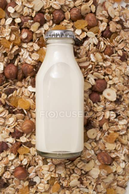 Cereal and bottle of milk — Stock Photo