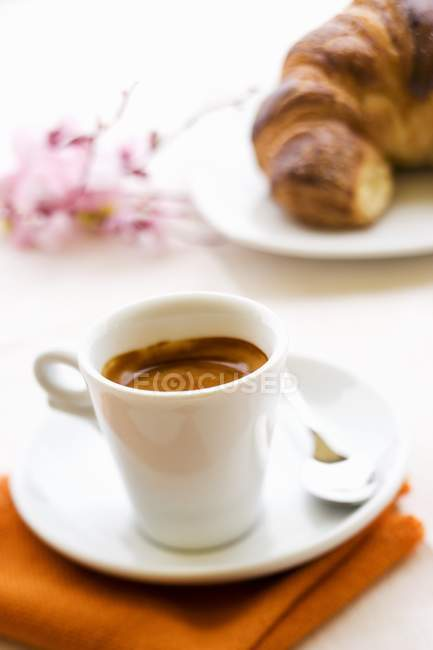 Cup of espresso with croissant — Stock Photo