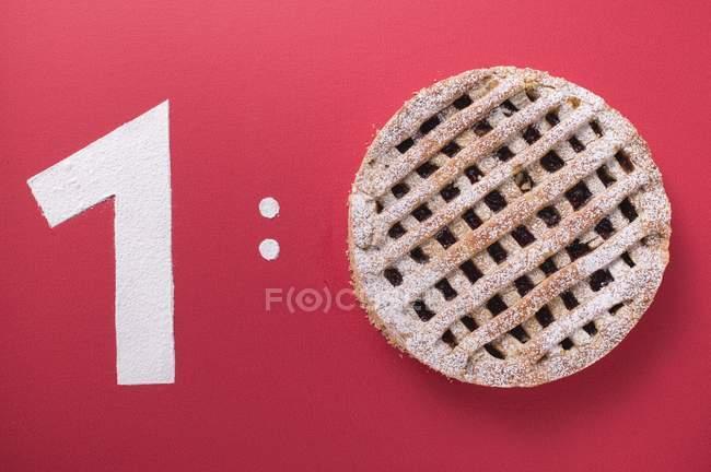 Крупным планом вид номер один и Linzer торт как нулевой символ Оценка — стоковое фото