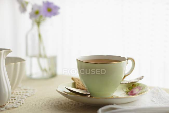 Tea in elegant china cup — Stock Photo