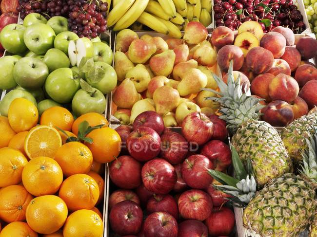 Various types of fruits in crates — Stock Photo