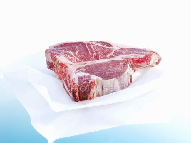 Porterhouse steak on paper — Stock Photo