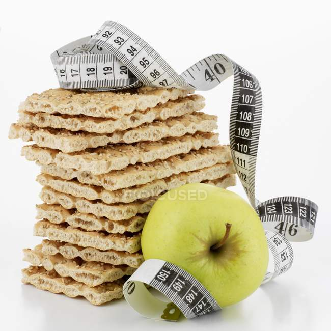 Crispbread in pile and apple — Stock Photo
