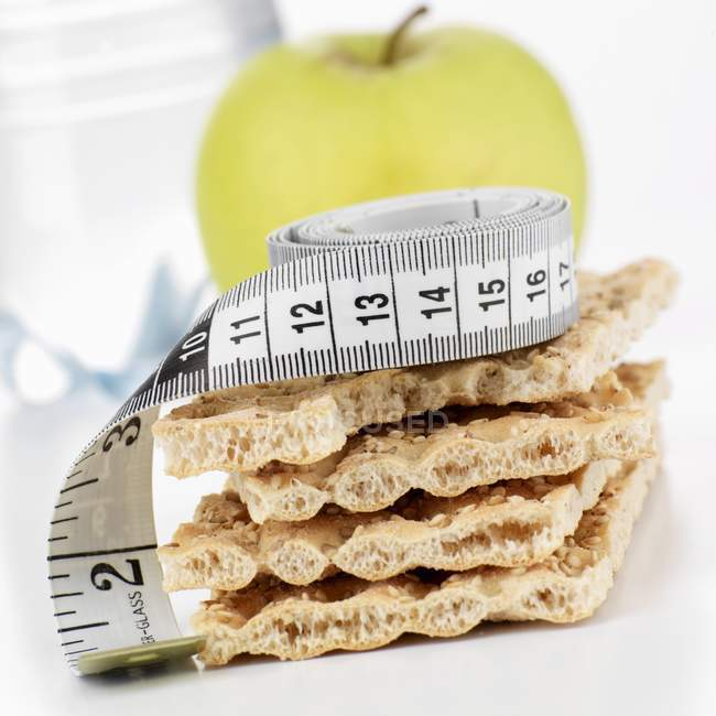 Crispbread with tape measure — Stock Photo