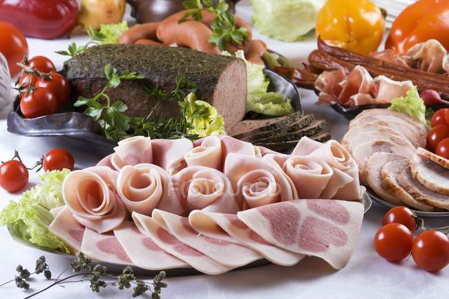 Cold lunch buffet with different meat and vegetables — Stock Photo