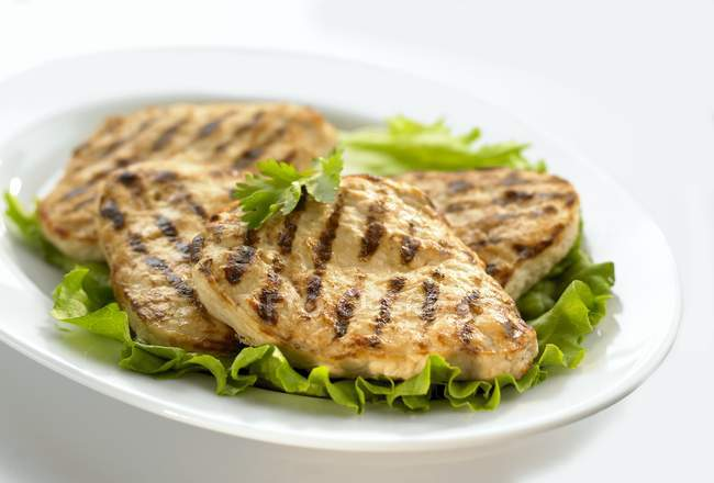 Grilled chicken breast slices — Stock Photo