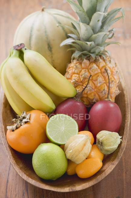 Exotic fruits over wooden table — Stock Photo