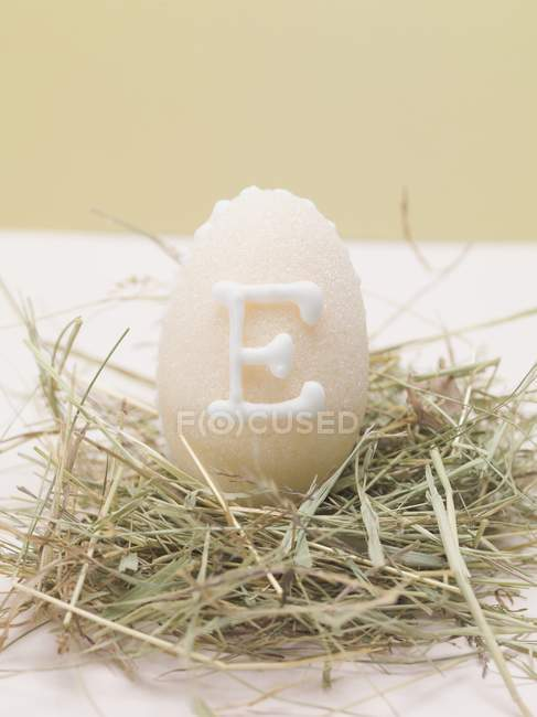 Closeup view of marzipan egg in Easter nest — Stock Photo