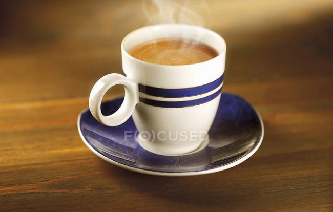 Cup of hot black coffee — Stock Photo