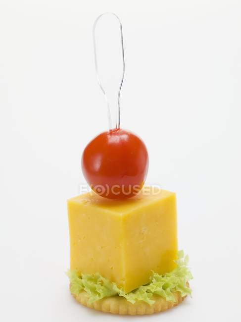 Cheese and cherry tomato — Stock Photo