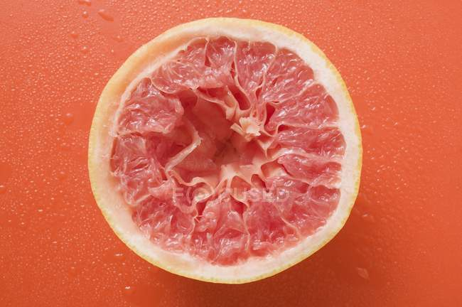 Pomelo rosa exprimido - foto de stock