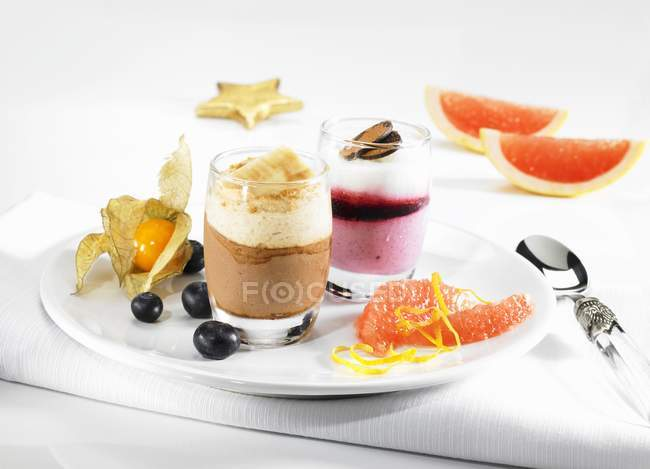 Closeup view of fruit desserts with blood orange slices, berries and physalis — Stock Photo