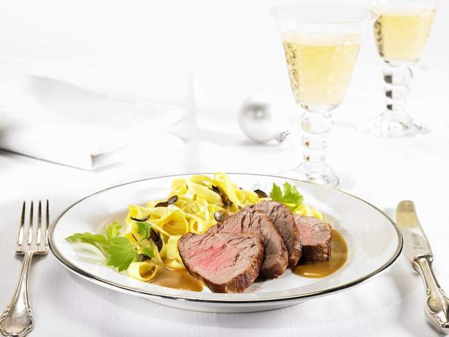 Veal fillet and truffle pasta — Stock Photo