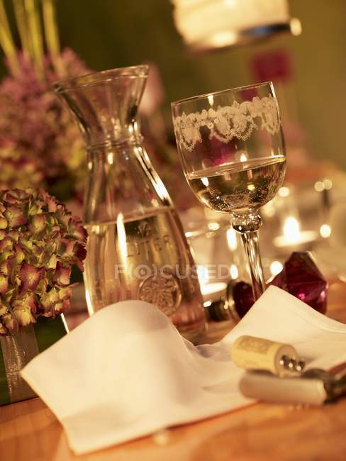 A festively decorated table with white wine — Stock Photo