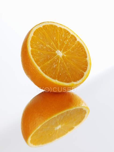 Half orange with reflection — Stock Photo