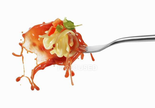 Pasta and squirted tomato sauce — Stock Photo