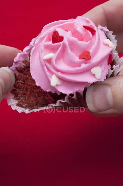 Human hands taking chocolate cupcake — Stock Photo