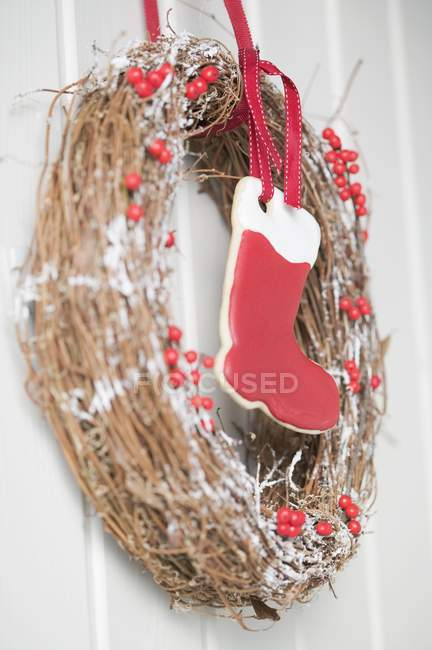 Christmas door wreath with red boot — Stock Photo