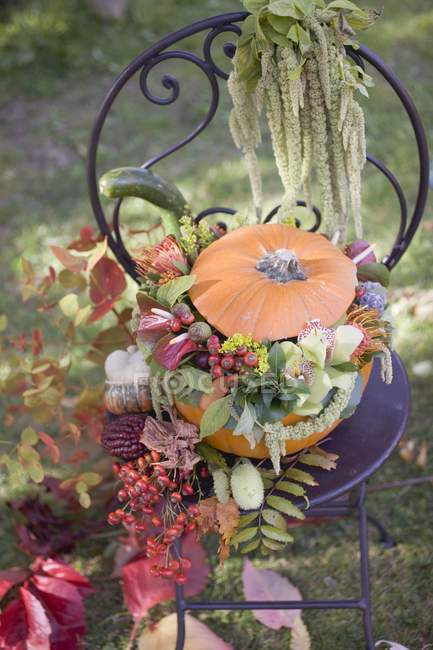 Pumpkin decorated with flowers — Stock Photo