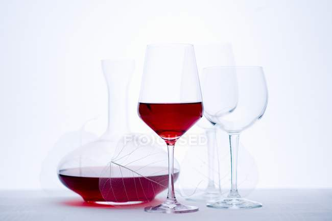 Glass of red wine and carafe — Stock Photo