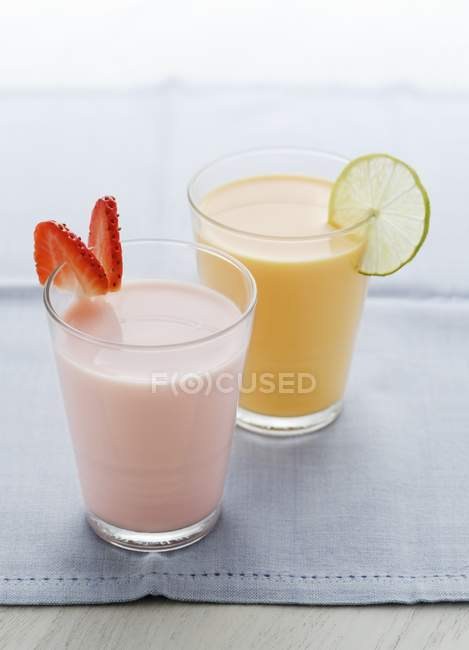 Strawberry milkshake and mango lassi — Stock Photo