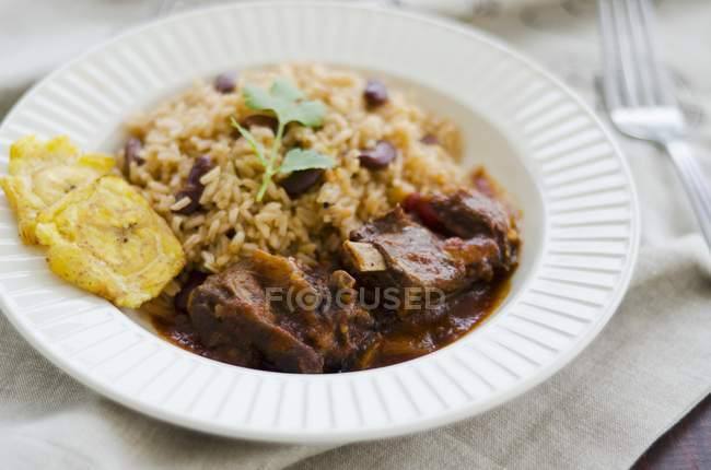 Goat ragout with beans and rice — Stock Photo