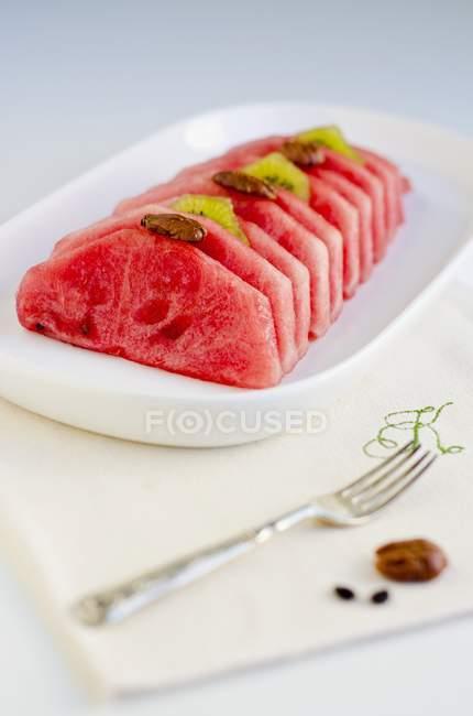Watermelon slices with kiwis — Stock Photo