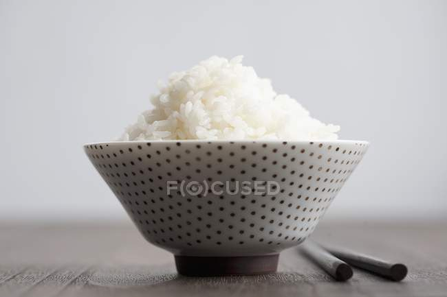 Bowl of rice with black sesame seeds — Stock Photo